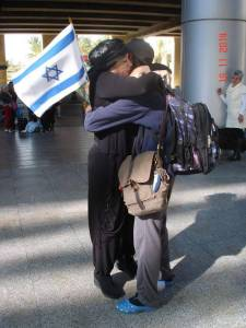 Mohammed and his Mom embrace at Ben Gurion Airport after being separated for 5 months.  Mohammed had to flee Israel for fear of his life.