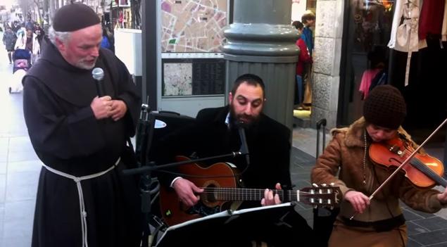 Rabbi and Priest Sing Together on Streets of Jerusalem