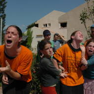 Jewish settlers cry as a soldier forces them to evacuate their home in the Jewish settlement of Neve Dekalim. Photo by Flash90